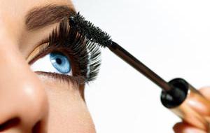 Mascara Applying. Long Lashes closeup. Mascara Brush. Eyelashes